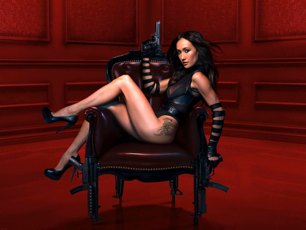 Maggie Q in black on a chair for Nikita TV show